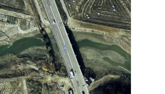 The satellite picture comes from the Naver Maps website. The bridge can easily be seen next to the main road to Ansan. Especially the shadow of the railway bridge is an easy give away of the location of the bridge.